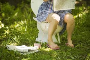 Sit on toilet